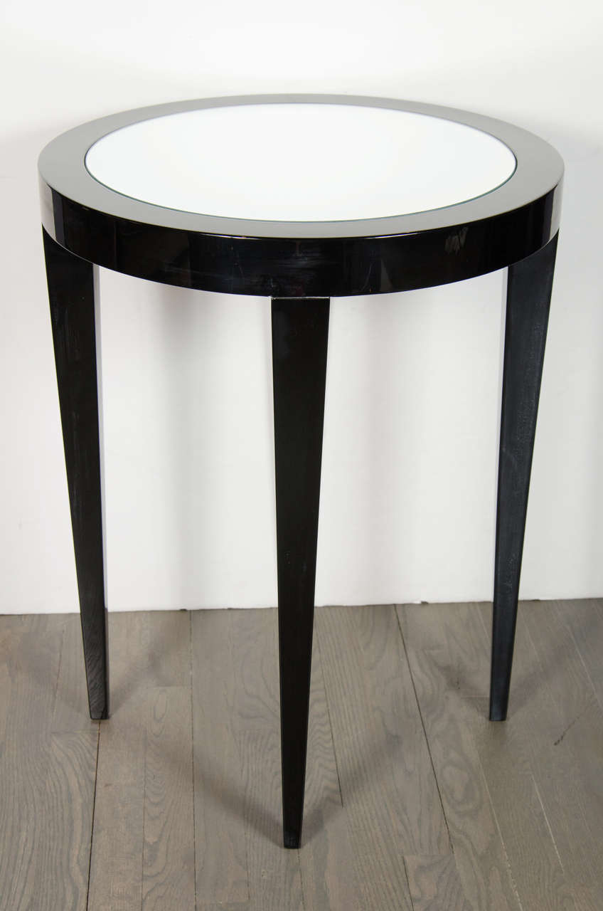 Luxe art deco side table with tapered legs and mirror
