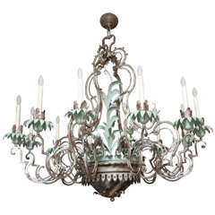 A Twelve-Light Palmette Silvered Metal Chandelier Attributed to  E.F Caldwell