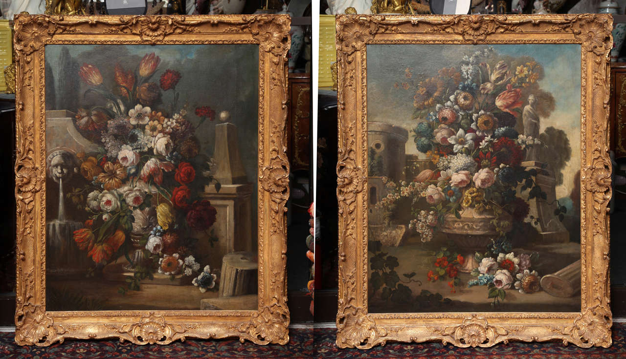 A fine pair of oil on canvas still life paintings of flowers, antique French, 18th century with original hand-carved giltwood frames. This pair is an excellent example of the French trend of emulating the Flemish still life tradition from the Dutch