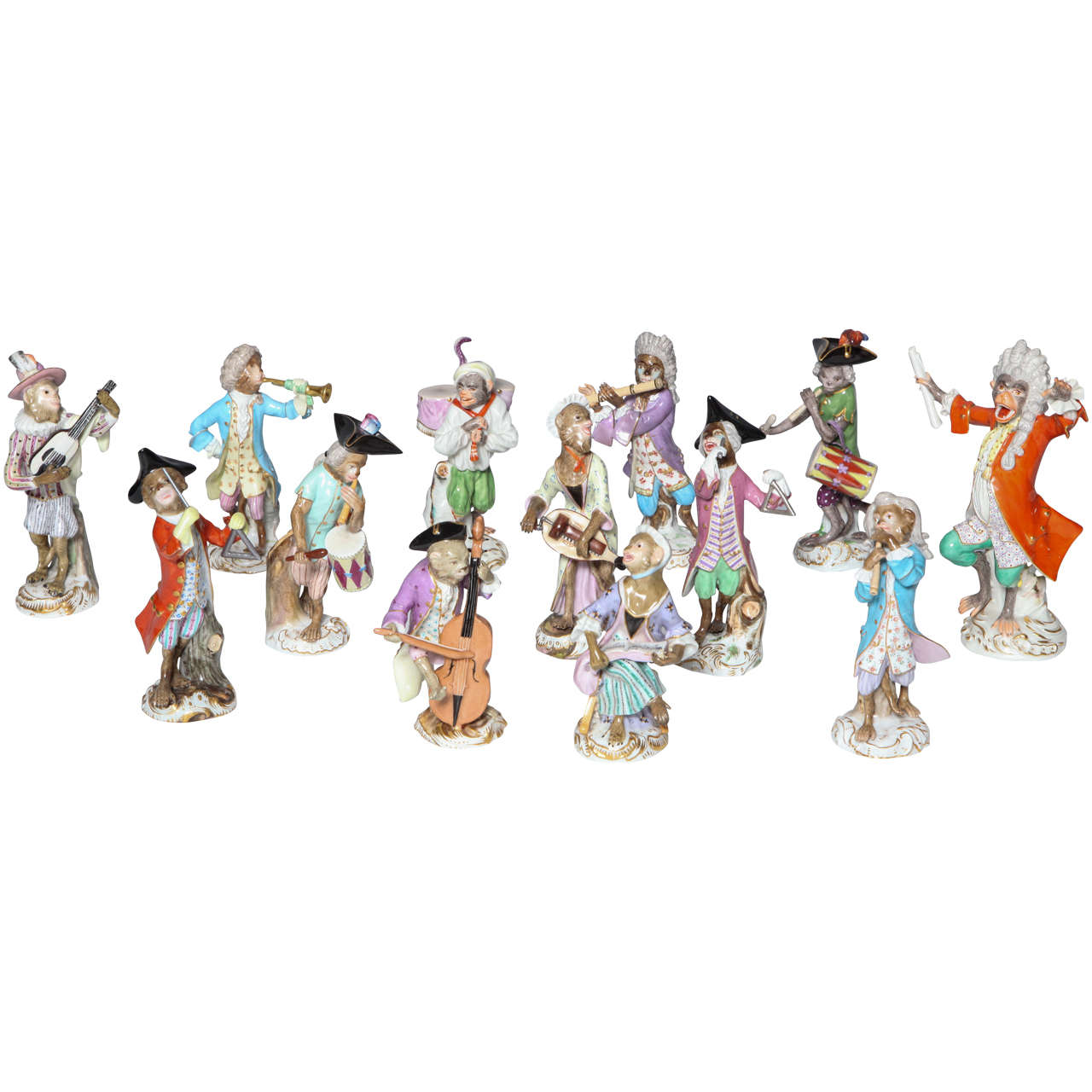 An early Meissen Porcelain Singerie style Monkey Musician Figurine. Dressed in full male noble attire and wig the monkey merrily plays the trumpet assuming both the stance and mannerism of a nobleman. After the 18th century models by Peter Reinicke