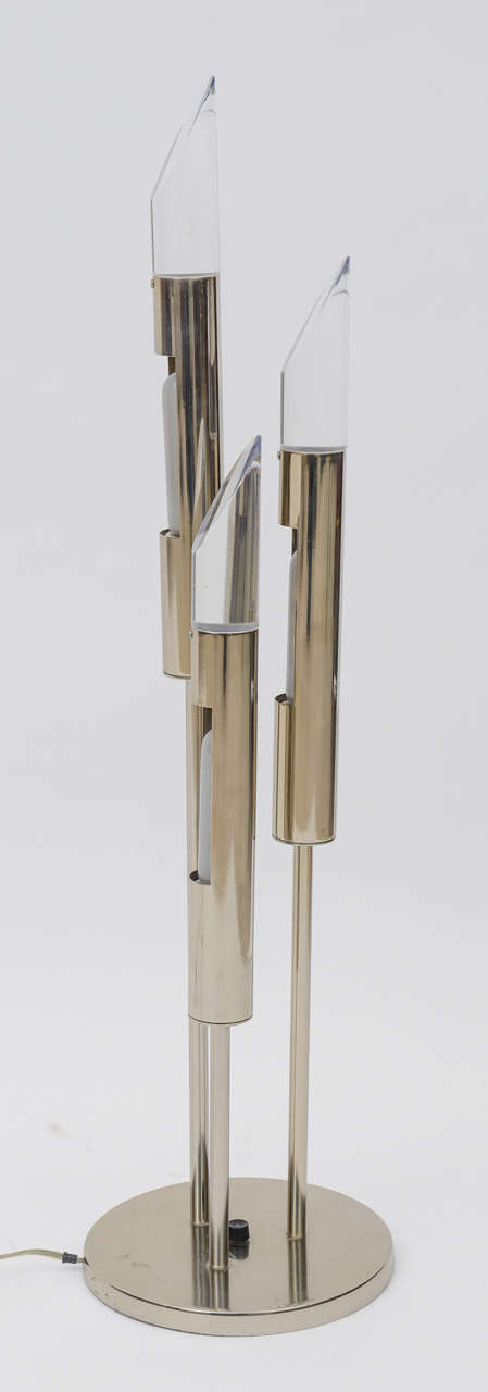 The graduated cylinder light sources on chrome rods with Lucite caps on a circular base.