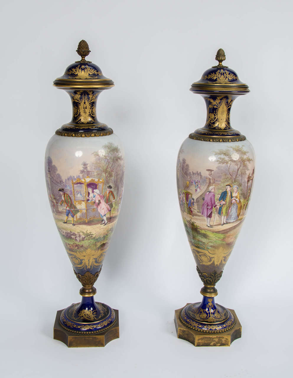 A very good quality pair of French Sèvres Porcelain, ormolu-mounted vases, depicting romantic scenes.  Signed; 'H. Desprez'.