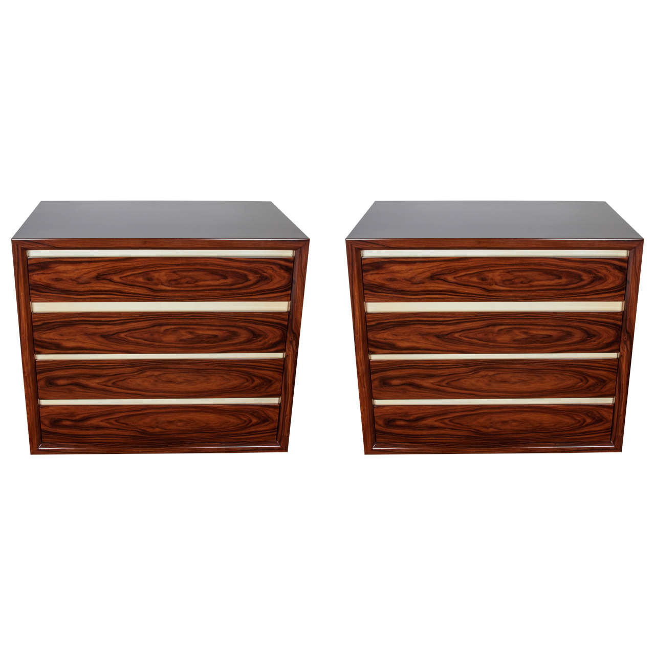 Exquisite pair of chests comprised of book matched rosewood with lacquered parchment (goatskin) trim. Each dresser is fitted with four drawers that feature a soft push-close. The commodes have streamline design and are handsome from all angles.