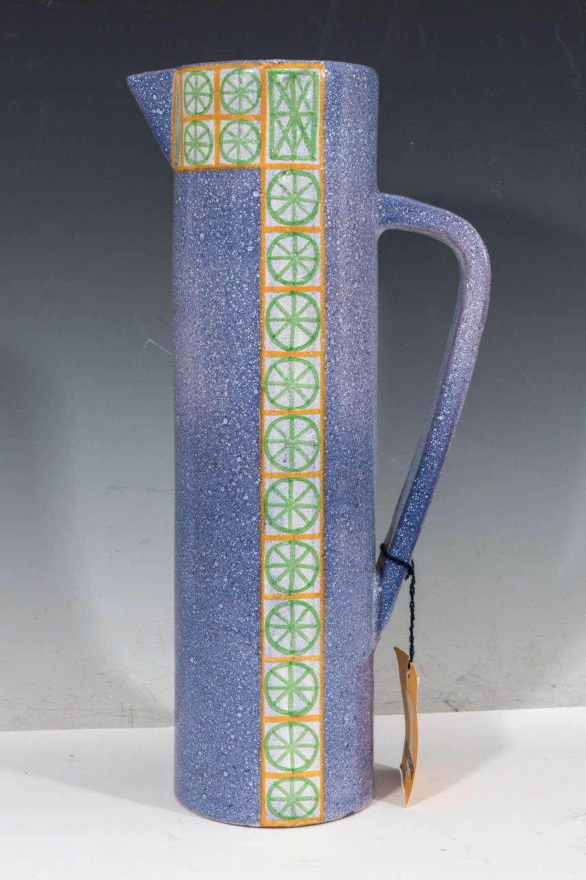 A vintage glazed and hand-painted ceramic pitcher, produced circa 1960s-1970s by Alfaraz workshop of Madrid, Spain, under the direction of ceramic artist Miguel Durán-Loriga. In addition to the maker's mark stamped to the bottom, is the original