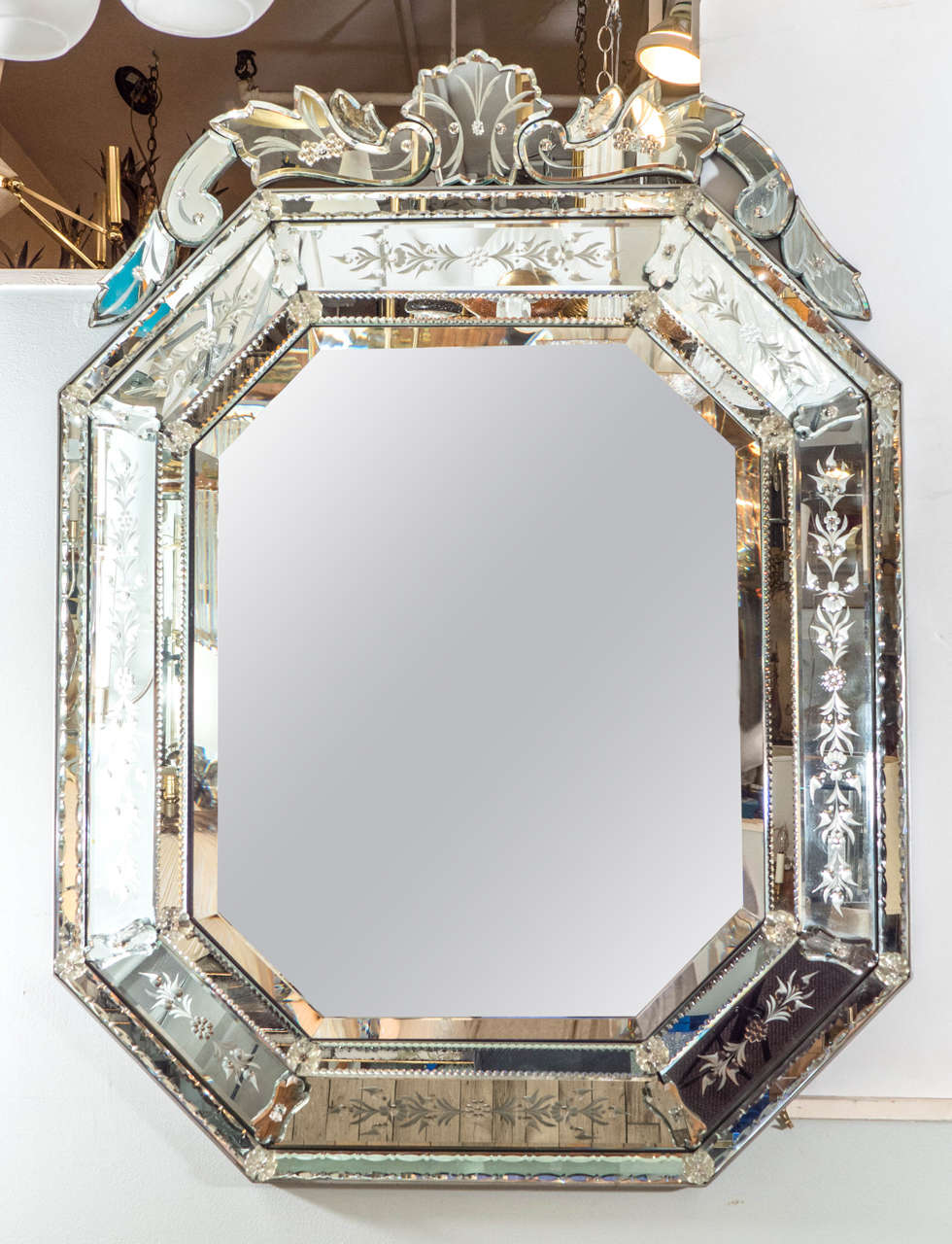 A Vintage Venetian Beveled And Raised Octagonal Wall Mirror Inset Against Silvered Wood Back