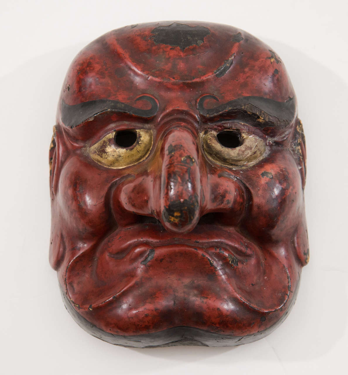 A rare Japanese comic demon Buaku Kyogen mask dating from the Edo Period, the golden age of Noh Drama.  The Buaku mask is a Kyogen version of the Noh Beshimi.  Kyogen were short, humorous skits performed between Noh acts to lighten the mood.  The