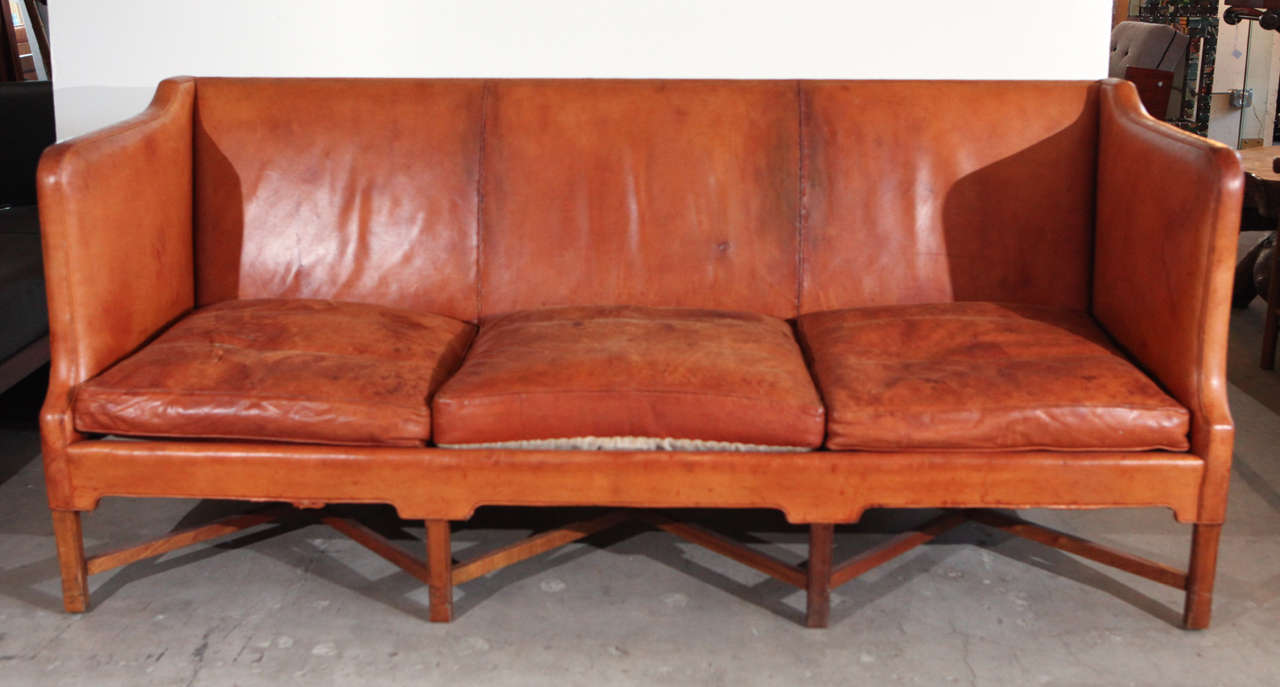 Denmark - Kaare Klint three-seat sofa in caramel leather, rare, 1940s.