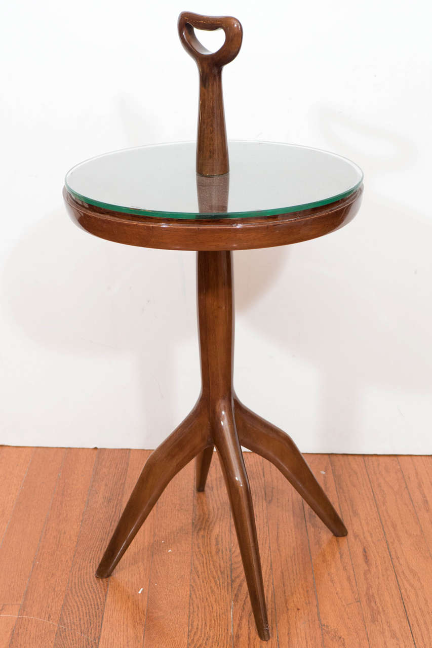 Lacquered wood table with glass top and handle.