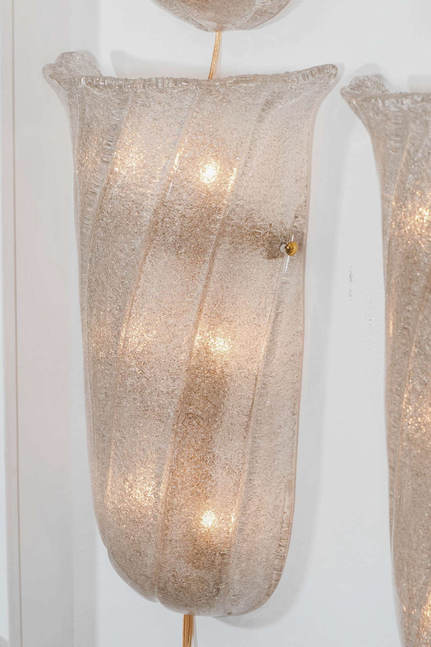 Pair of frosted Murano glass sconces with twisted fluting and brass finial detail. (Additional pairs available)