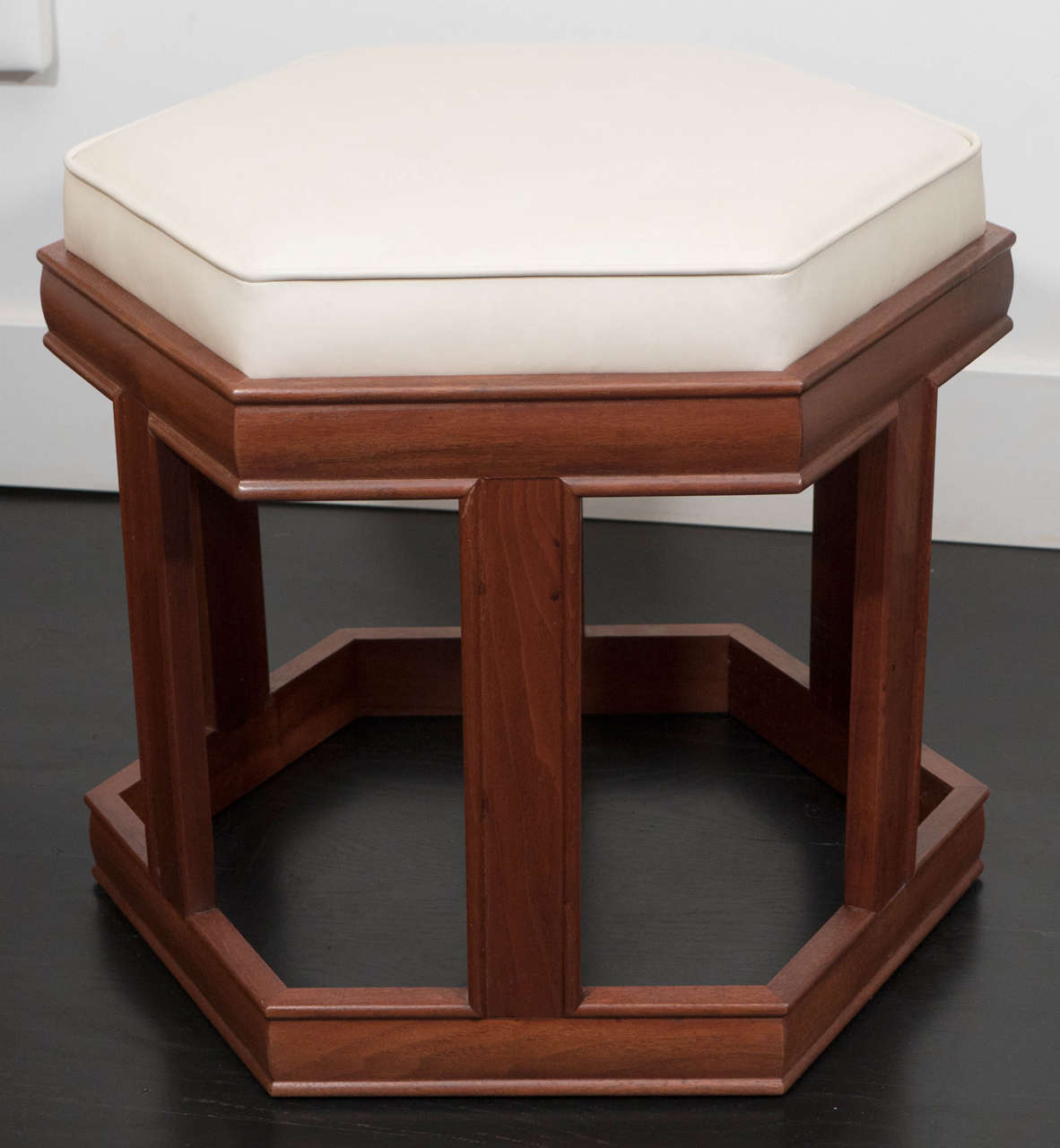 Hexagonal stools with leather seats and mahogany frames designed by John Keal for Brown Saltman.