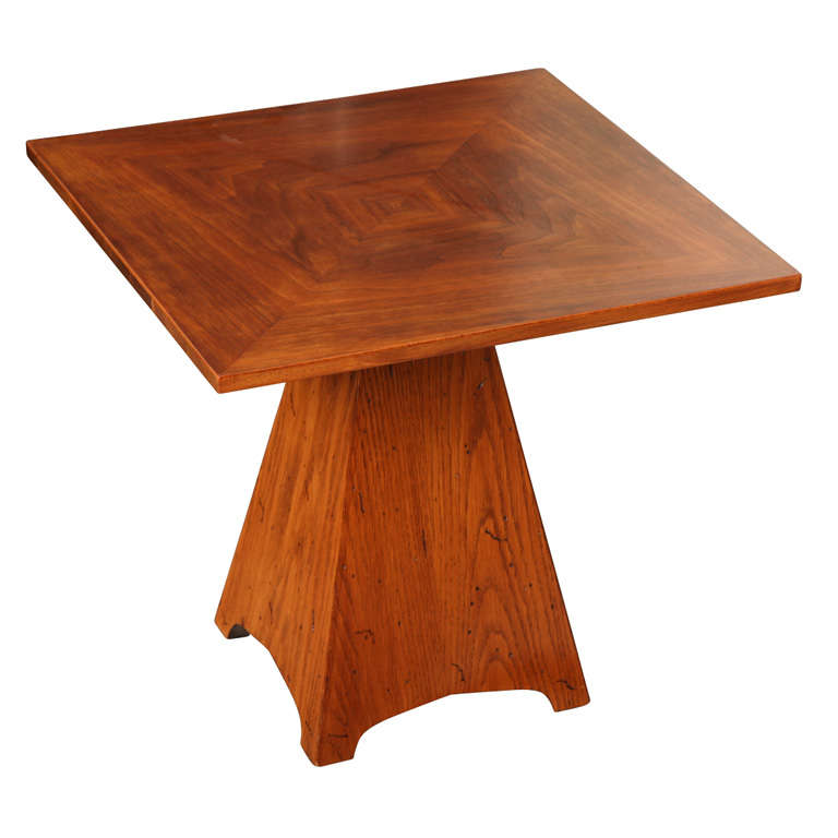Square walnut side table with a triangular oak base c