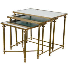 A Mid Century Set of Three Mirror and Brass Nesting Tables