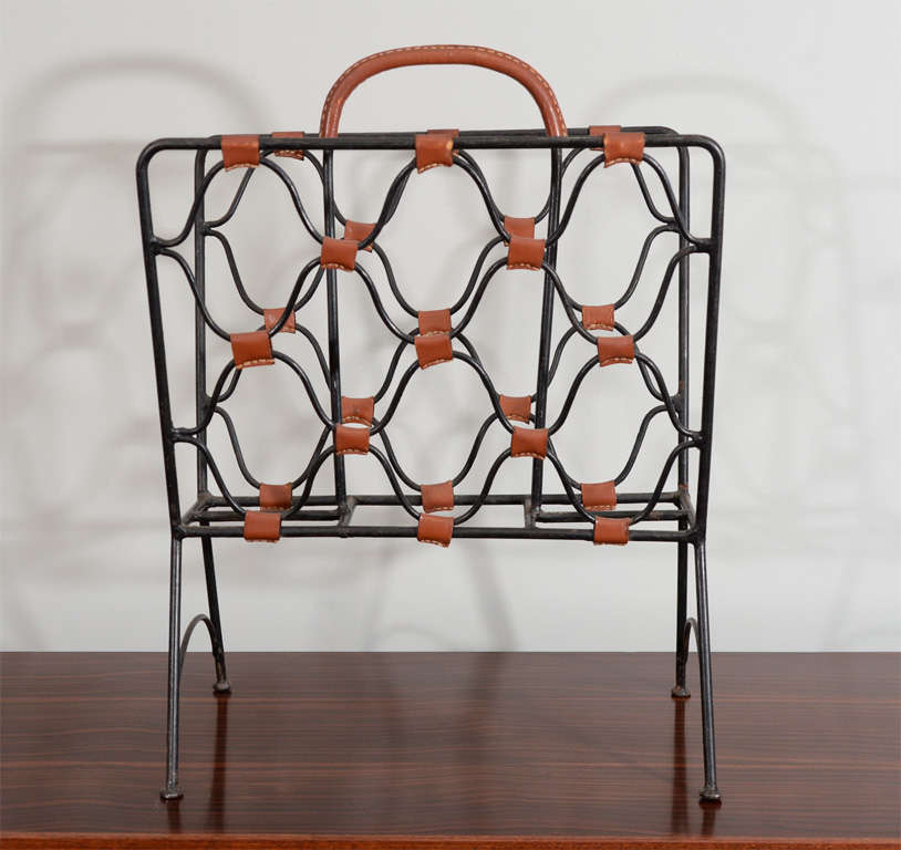 Leather and iron magazine holder by Jacques Adnet with top stitched leather accents. beautiful patina.