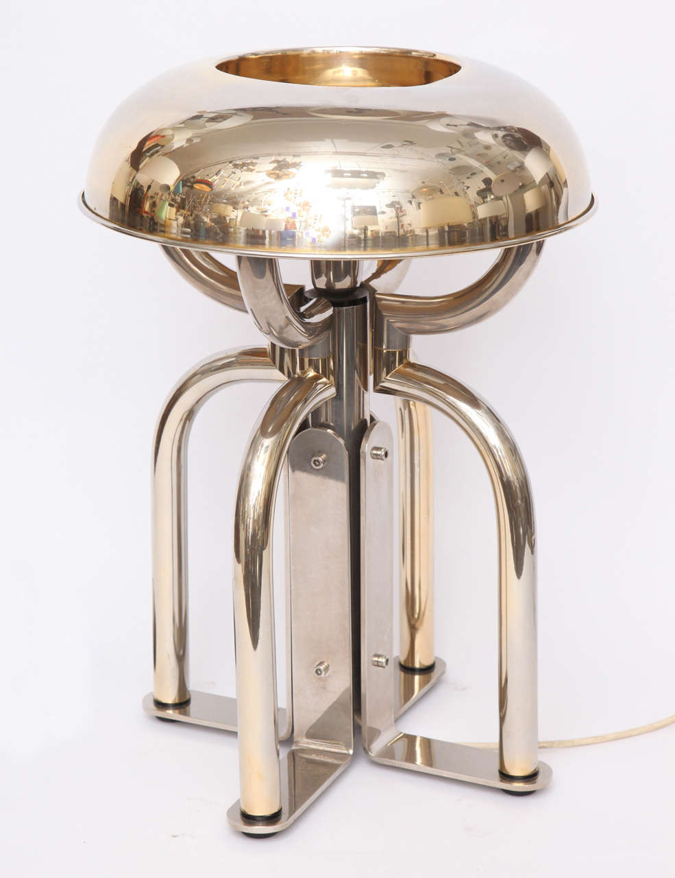 A 1970s French architectural brass and nickel table lamp.