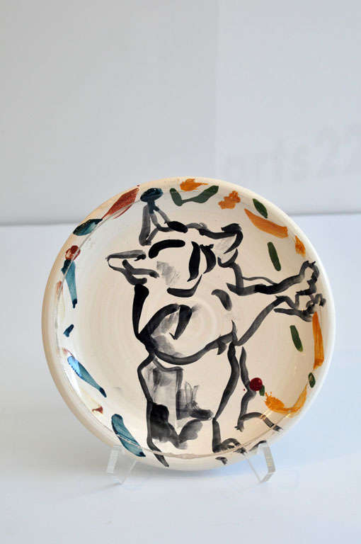 A very early ceramic plate by Los Angeles postmodernist artist Peter Shire (b. 1947). Incised signature and dated 1-15-75 on back. The lively, vibrant design is of an animal figure. Well-known for his constructivist-inspired teapots of the 1980s,