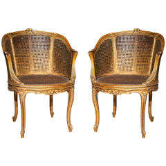Pair of Caned Bergere Chairs by Jansen