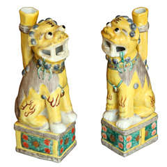 A Pair of Chinese Polychrome Decorated Seated Foo Dogs, 20th c.