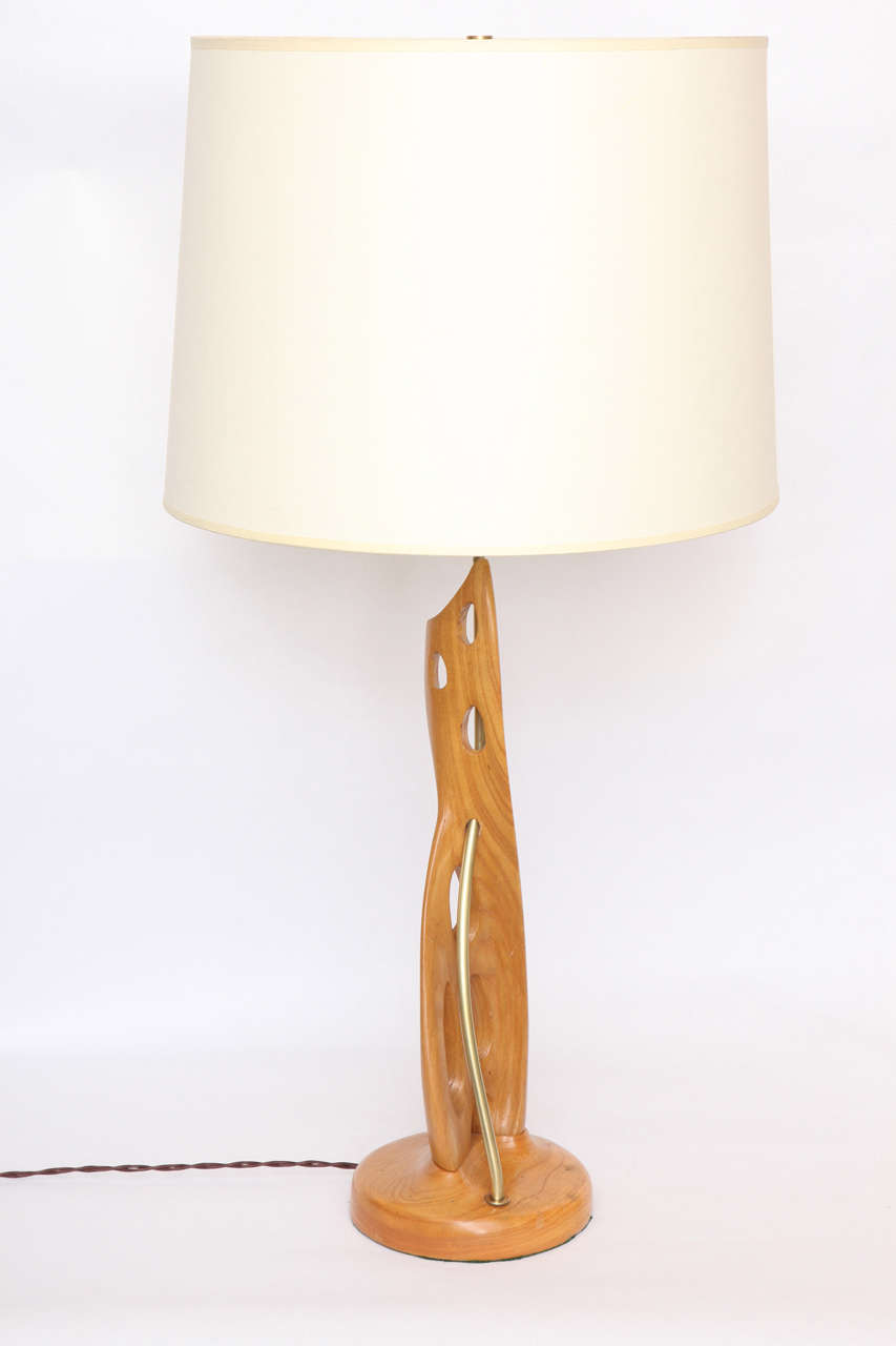 A pair of 1950s wood and brass sculptural table lamps. Shades not included