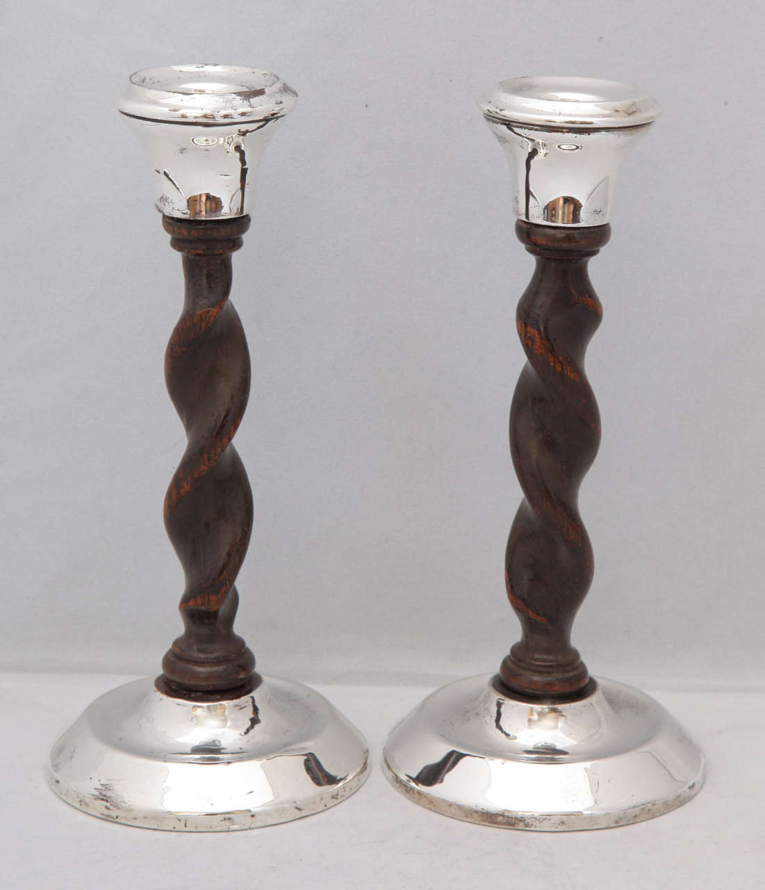 Art Deco, Jacobean-style, sterling silver and barley twist wood candlesticks by Joseph & Richard Griffin, Chester, England, 1925. Measures: 7 3/4