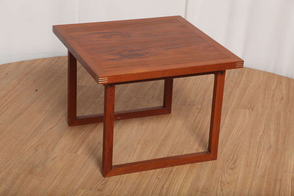 Small side table made of solid walnut, with very elegant inlaid brass on the corners.