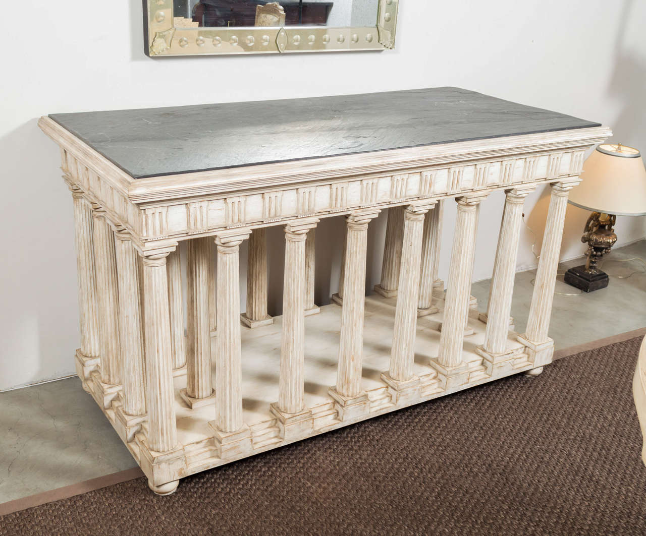 Hand-painted and antiqued slate top architectural center table. Rectangular charcoal slate top raised on a base in the form of a classical temple, the frieze of traditional form with triglyphs and metopes raised on a series of fluted Doric column