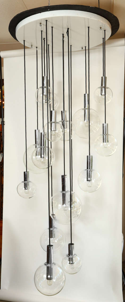 Giant sixteen-globe chandelier by RAAK. The chandelier comprises of four various size clear globes, the largest being 11