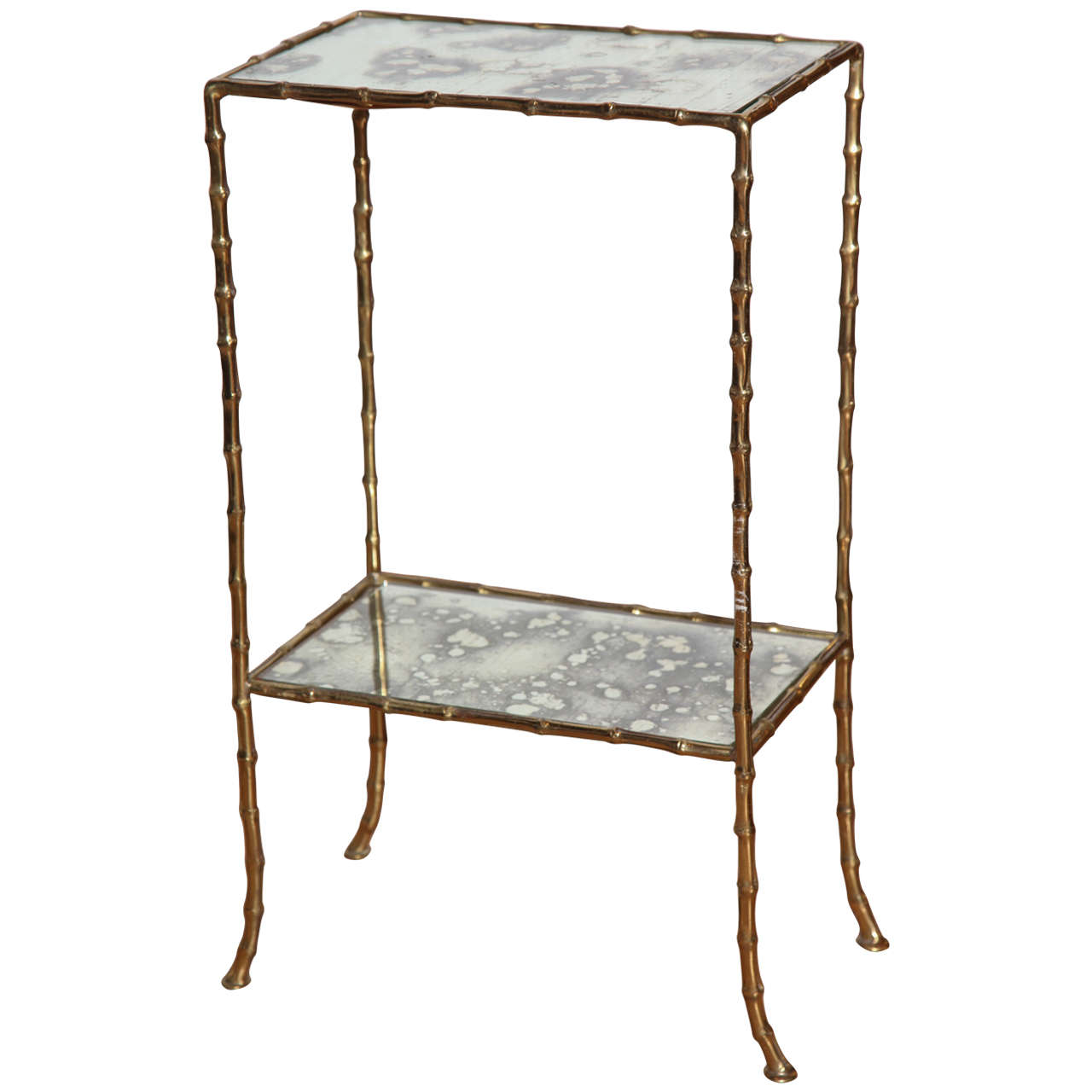 A gilt brass and antiqued mirror faux bamboo etagere table for Miroir etagere