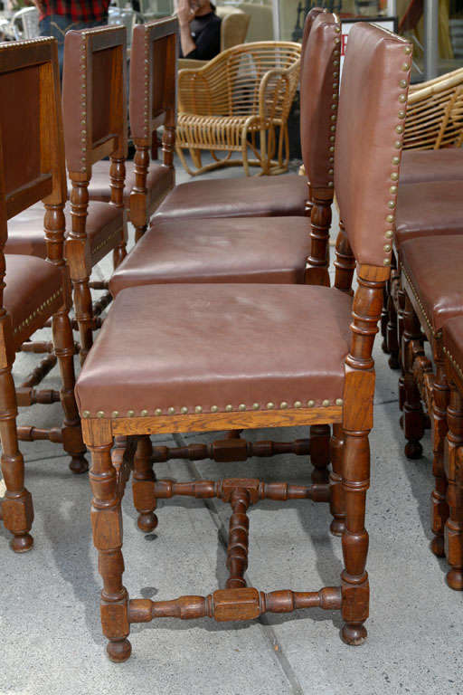 Renaissance Revival Set of Ten Leather and Oak Dining Chairs For Sale
