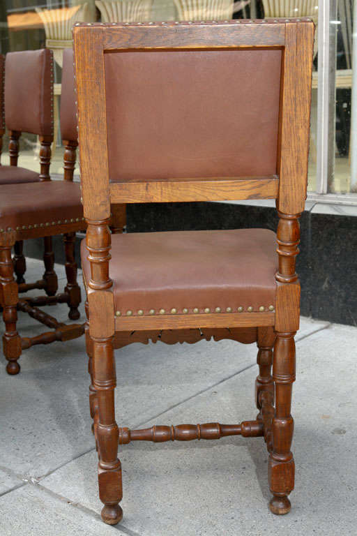 Danish Set of Ten Leather and Oak Dining Chairs For Sale