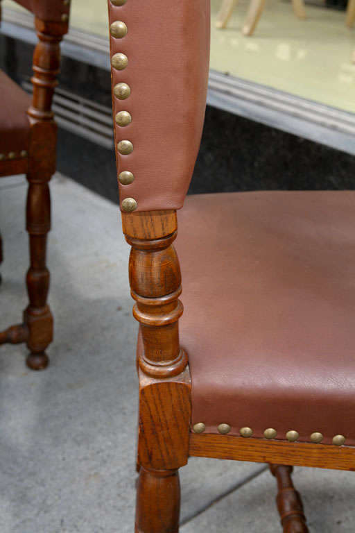 20th Century Set of Ten Leather and Oak Dining Chairs For Sale