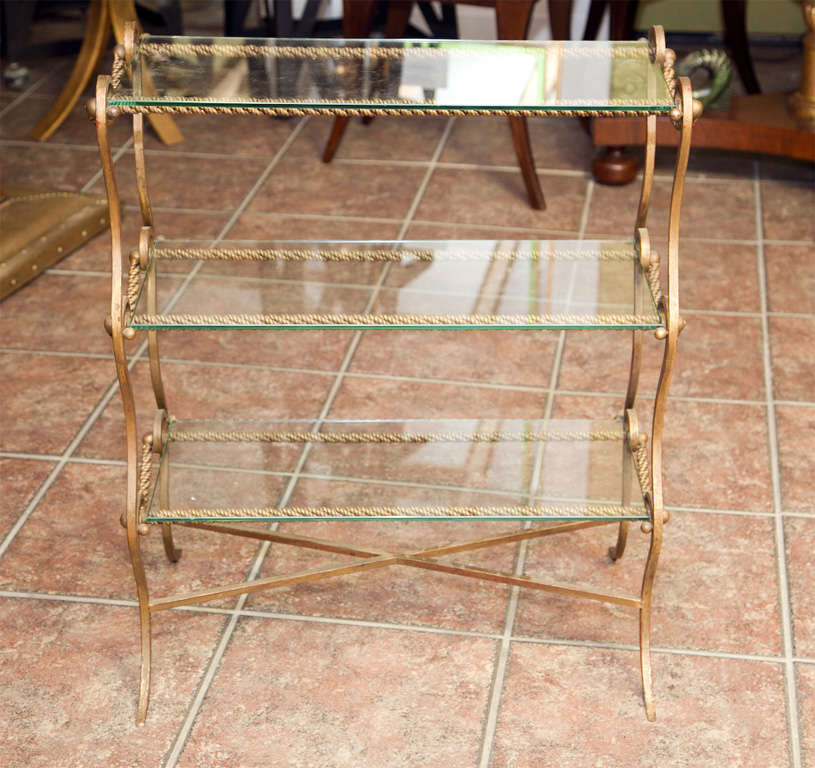 Metal end table with twisted rope design and three glass shelves