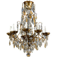 Antique Chandelier. Jansen chandelier of gilt bronze and crystal