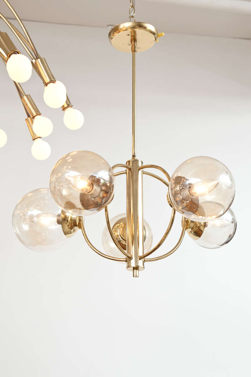 "Vintage Italian chandelier with curved brass arms and five glass globes. Hand blown glass balls range from 4"" - 6"" in diameter."