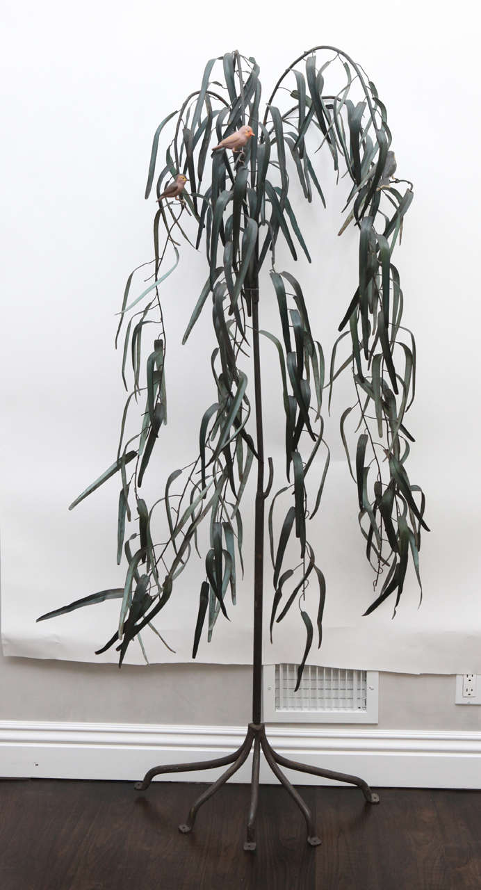 20th century Italian iron sculpture of tree with three birds. The sculpture is painted green. It can be used indoors or outdoors.