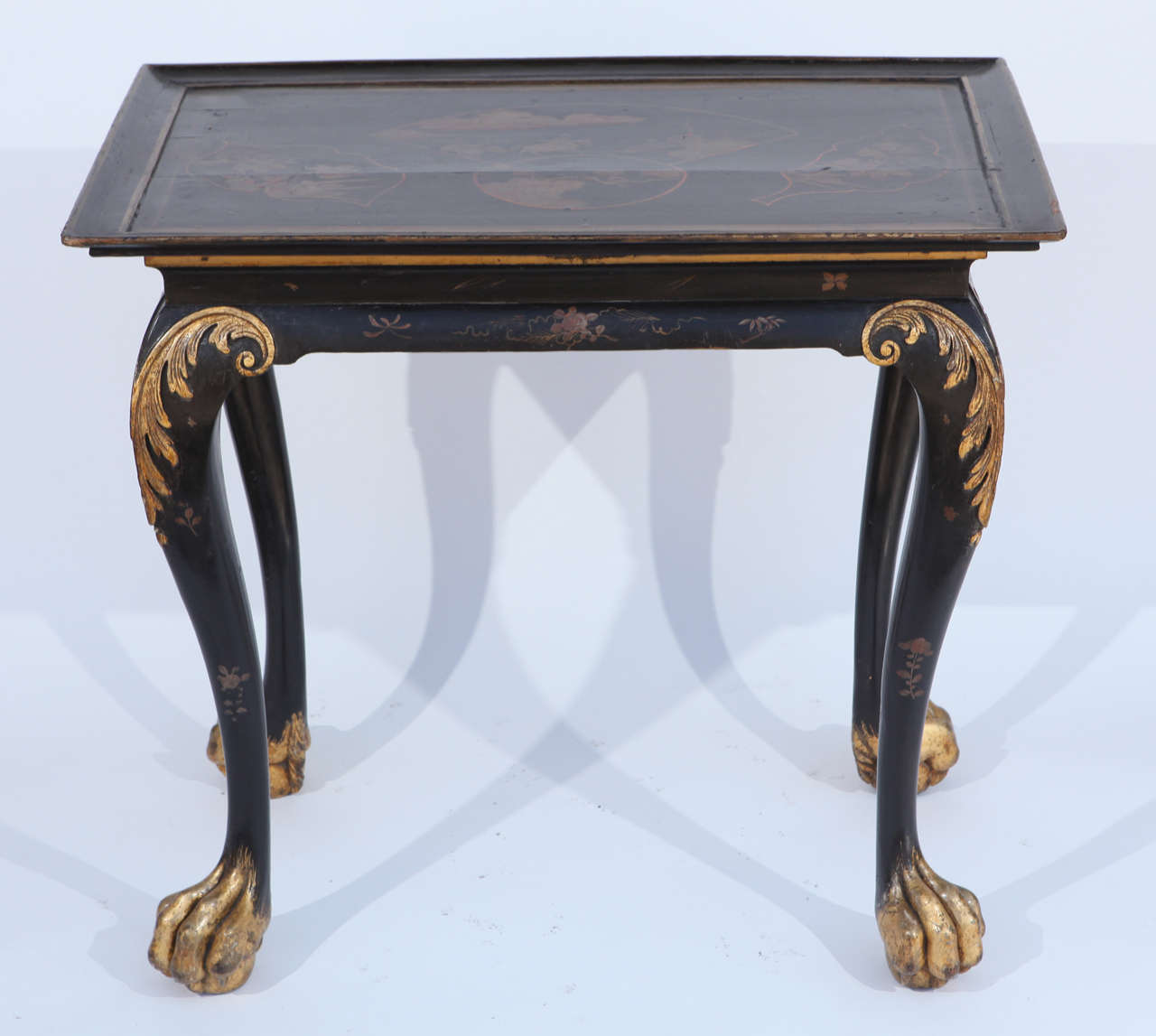 19th century English Chinoiserie Hardwood Table with Paw Feet and Gilt Details