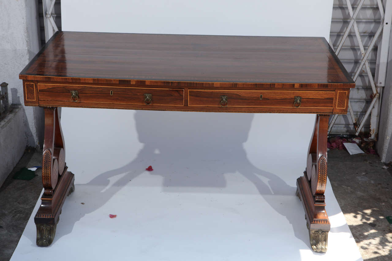 Period 19th century English Regency Desk with Satinwood inlay with two drawers and bronze mounted feet.