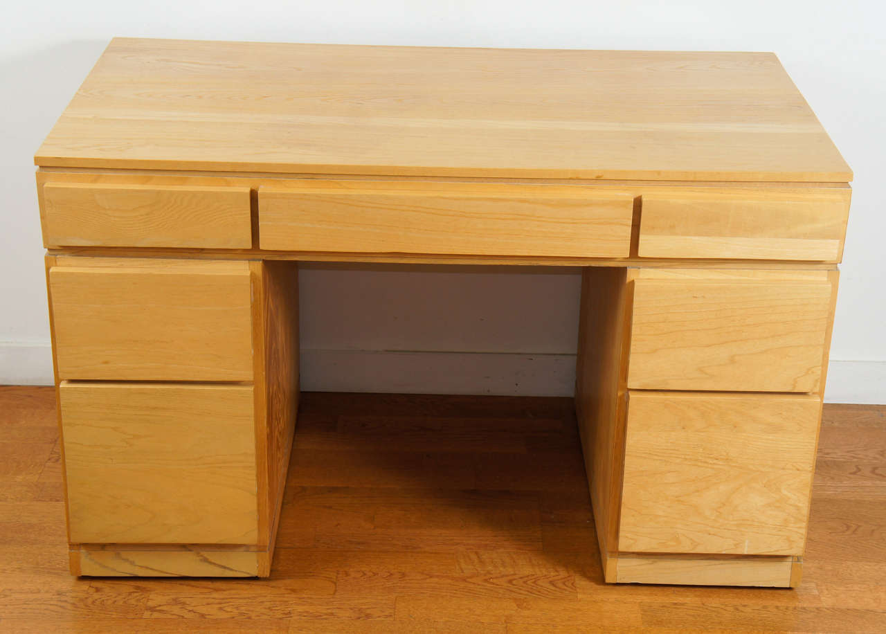 1940s style, knee hole desk. Shown in solid oak. Features, seven generous drawers, and clean lines. Custom finishes available.