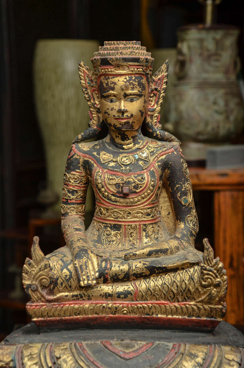 Lacquered 19th Century Carved and Parcel-Gilt Cambodian Seated Buddha in Royal Dress For Sale
