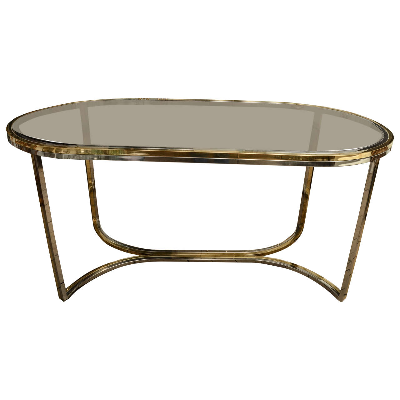 Chrome and brass oval dining table with smoked glass top for Glass dining table