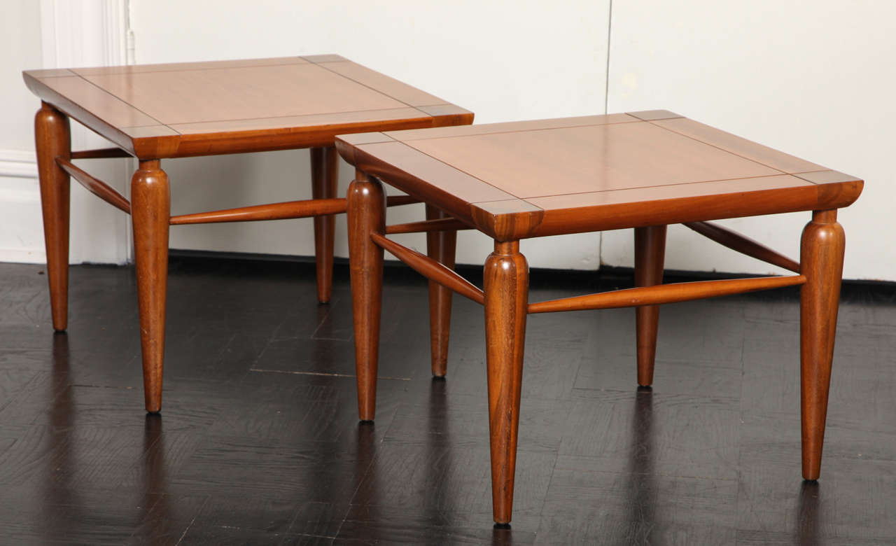 Pair of Mid-Century walnut tables, square tops on round tapered legs