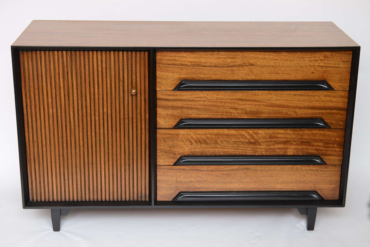 Exciting credenza, server or sideboard buffet. Milo Baughman designed in 1952, the Perspective Line for Drexel, exclusive to Bloomingdale's in New York. Featuring Primavera wood finishes with carved wood pulls incorporated in the body of the
