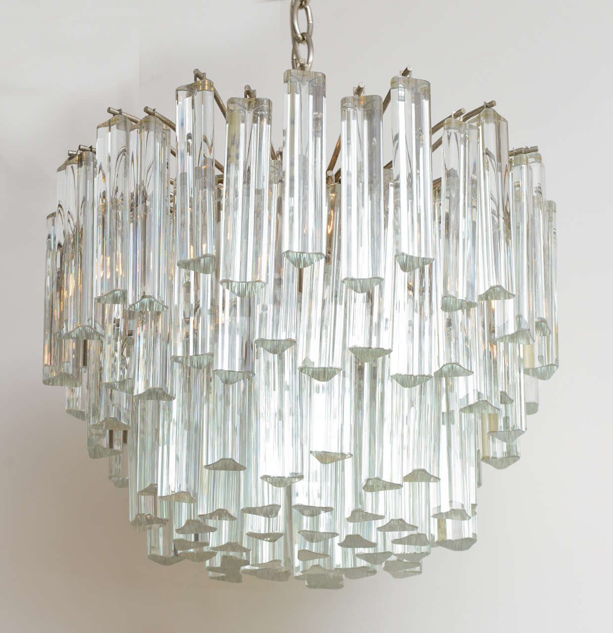 REDUCED FROM $3,750 Stellar Camer glass chandelier, lushly adorned with fat Venini triedri crystals. Stunning, compact with 105 crystals and with four light sources taking medium base bulbs.  Measures: 16