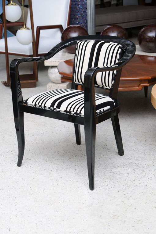 The black lacquer frame with an upholstered seat and back.