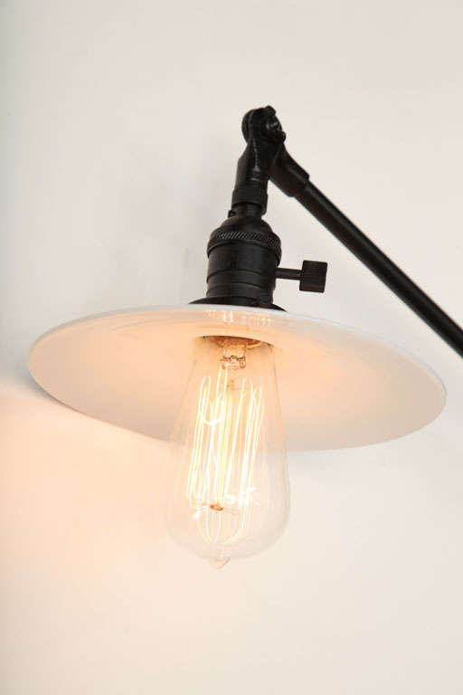 Vintage OC White Industrial Wall-Mount Swing-Arm Lamp In Excellent Condition For Sale In New York, NY