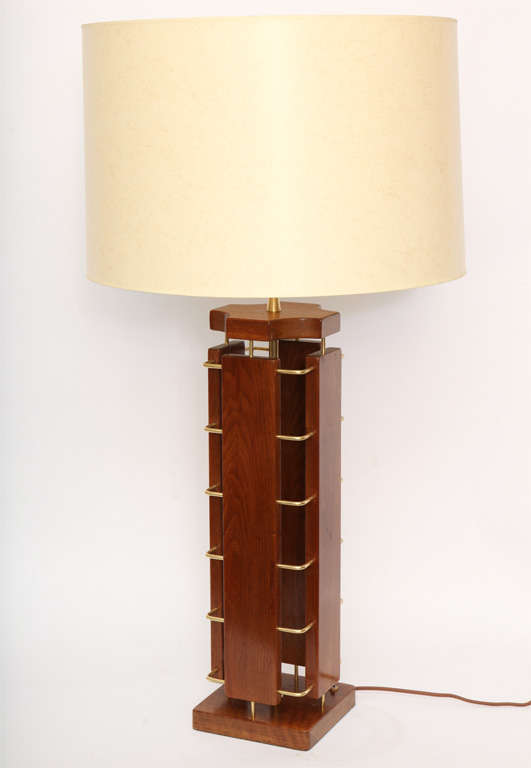 A 1950s architectural wood and brass table lamp. Shade not included