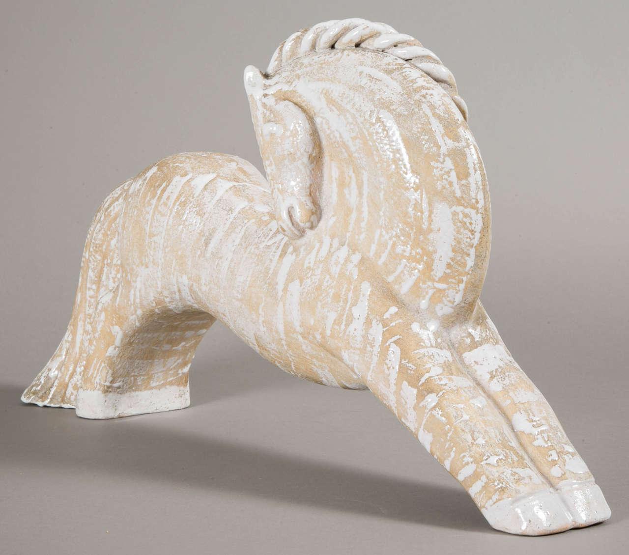 Primavera, circa 1938. Atelier du Printemps. Elegant stylized beige enamelled terracotta horse. Signed Primavera, Made in France.  Reference: One similar model seen in the movie Ninotchka, E.Lubitsch, 1939. In the spirit of̀ Colette Gueden.