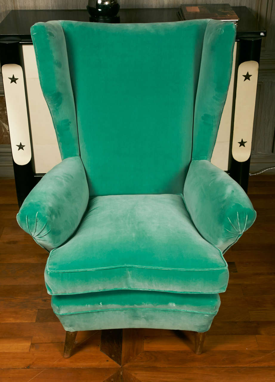 Pair of comfortable wingchairs with arched front, upholsered with Rubelli velvet