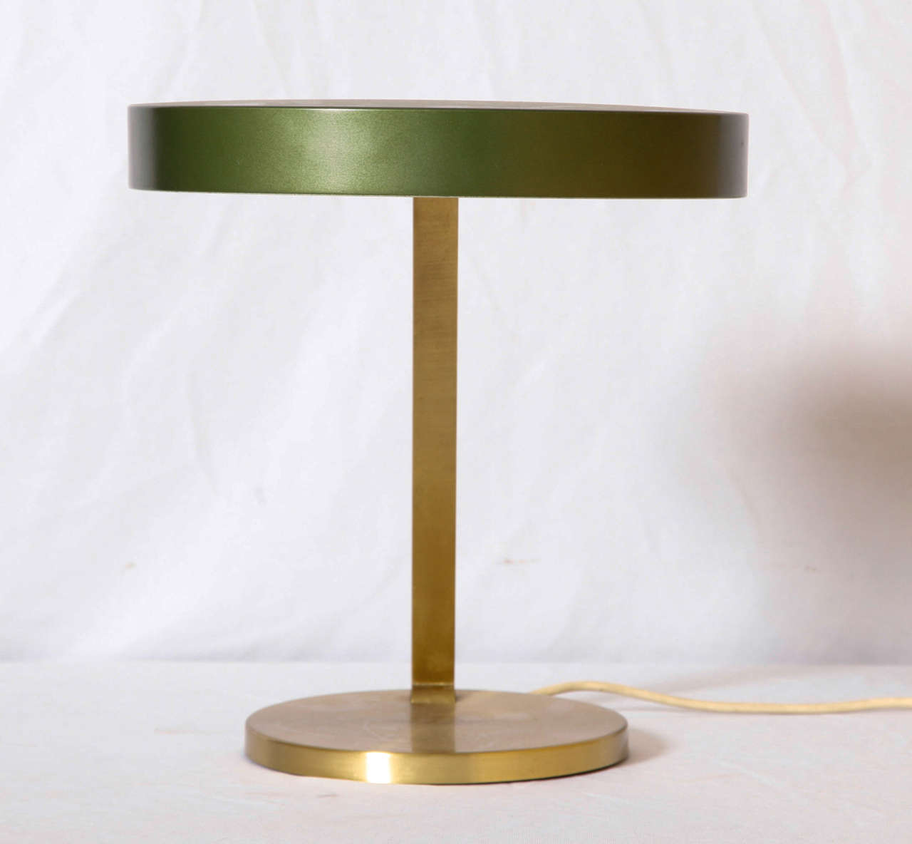 Adjustable Desk Lamp Having An Enameled Emerald Green Shade Connected By A  Curved Brass Stem And
