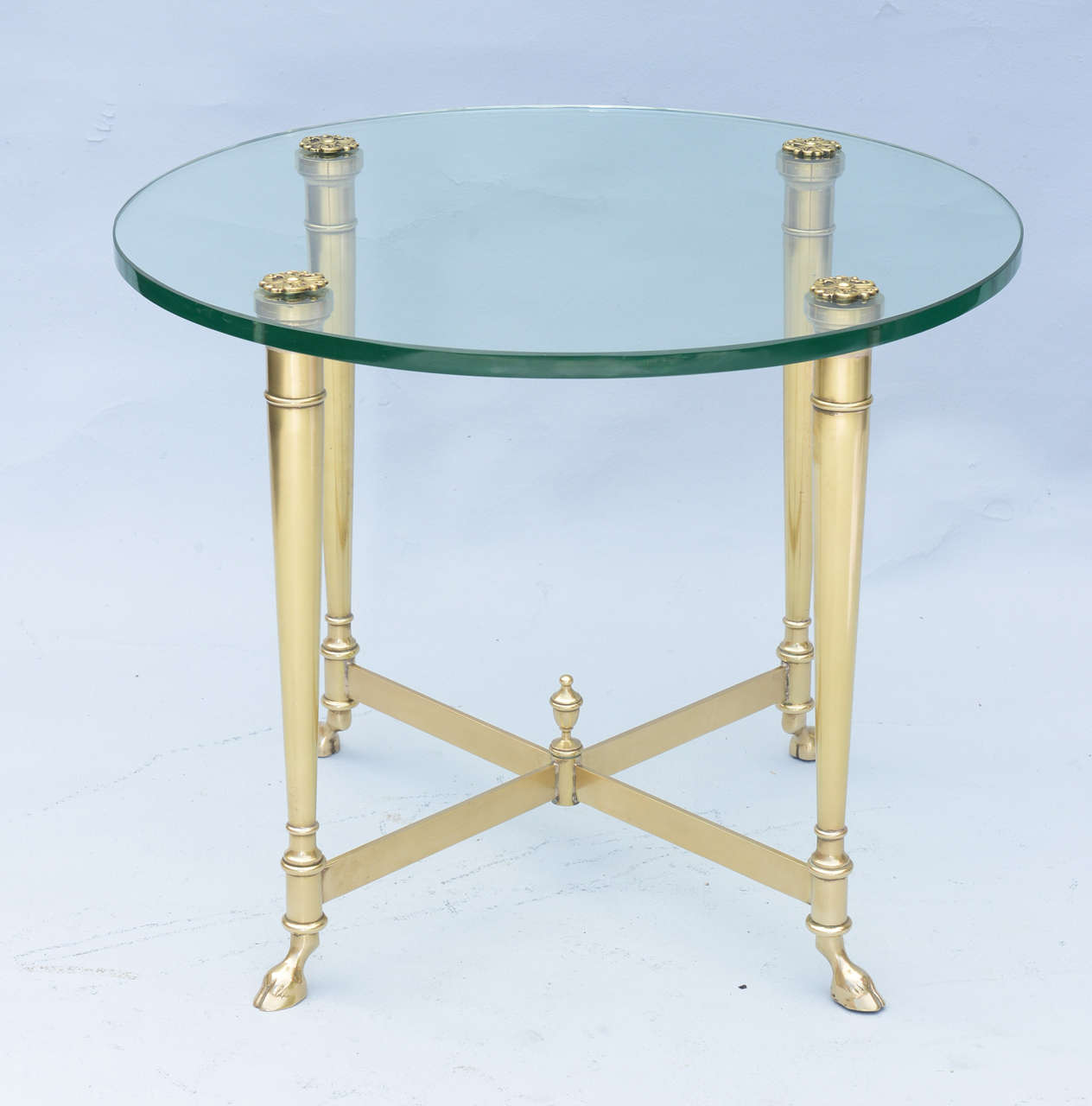 Jansen style single side or end table of polished brass its round glass
