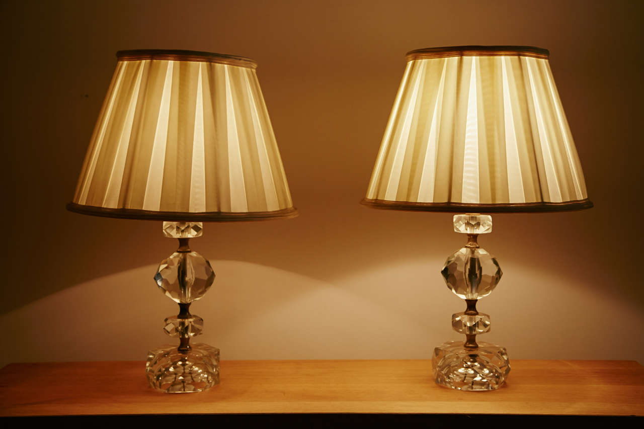 Refined pair of cut-glass table lamps, France, 1950s.